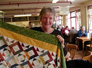 Jean Morris with one of the quilts